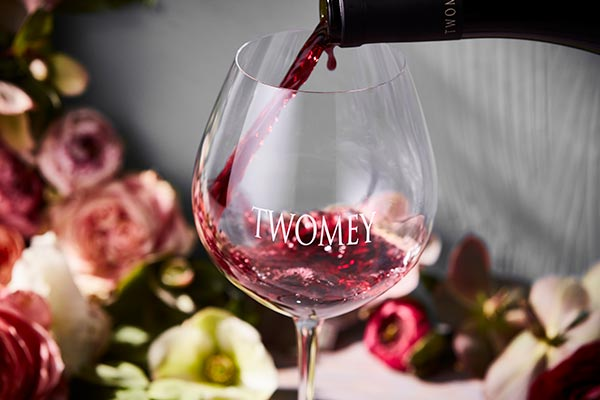 Pouring a glass of Twomey Pinot Noir